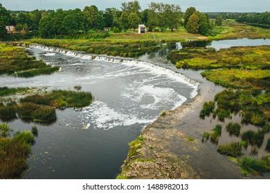 Venta Rapid waterfall, the widest waterfall in Europe and long brick bridge, Kuldiga, Latvia. Captured from above