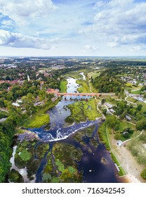Venta Rapid waterfall, the widest waterfall in Europe and long brick bridge, Kuldiga, Latvia. Captured from above.