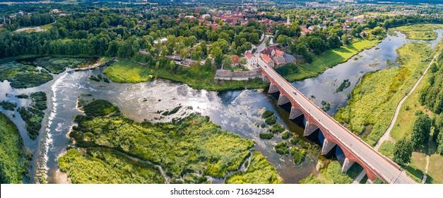 Venta Rapid waterfall, the widest waterfall in Europe and long brick bridge, Kuldiga, Latvia. Captured from above.
