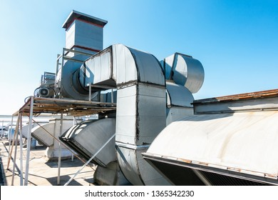 Ventilation Air Duct and HVAC System, Exhaust Hood for Air Blower in Manufacturing Food. Air Vent Blowing and Exhausting Machine Equipment on Roofing Floor in Department Store