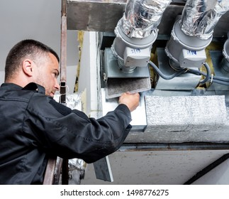Ventilation cleaning. Specialist at work. Repair ventilation system (HVAC). Industrial background