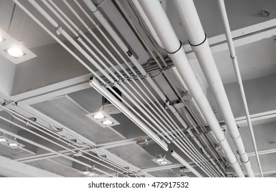 ventilation and cooling ventilation system on the ceiling. Indoor ventilation pipe with light.