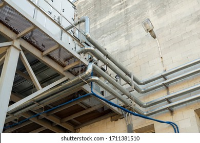 ventilation and cooling systems installed on the street outside the building
