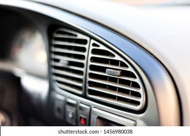 ventilation grilles in the car close-up, car air conditioner heating, faulty air conditioner concept, bad smell in the car, refilling refrigerant in the car air conditioner