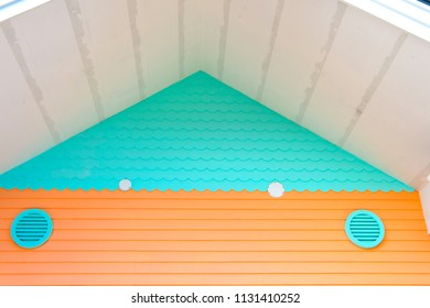 Ventilation on house. Whole house ventilation systems. Ways to ventilate your home. Air grate turquoise color on building facade. Provide fresh air into house.