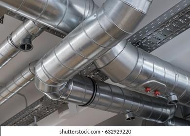 Ventilation pipe system in kitchen interior.