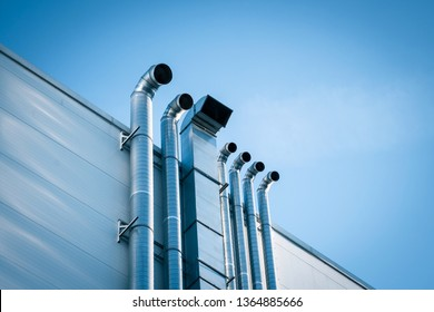 ventilation pipes on the facade of the building