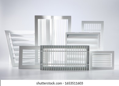 Ventilation of residential premises. Plastic and metal ventilation grilles. Industrial grilles for air conditioning. Different types of ventilation grilles on a white background.
