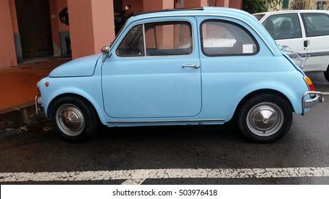 Ventimiglia, Italy - October 23, 2016: Small Italian Car Fiat 500 Parked on the Street of Ventimiglia. Blue Fiat 500 L