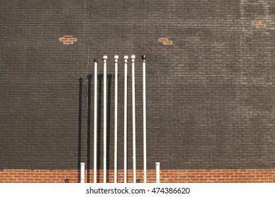 Vents on a black brick wall