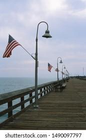 Ventura, California - November 10 2018: American flags line the famous Ventura Pier.