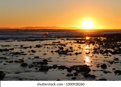 Ventura, California Pier and C Street beach at evening sunset an