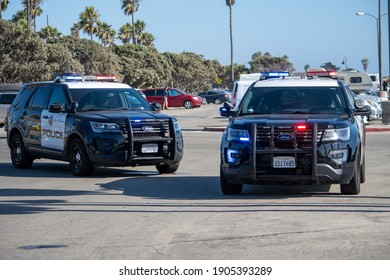 Ventura, California, United States -  August 7, 2020: City of Ventura Police Department SUVs at the scene of a search of a suspect's vehicle at Ventura Harbor.   Ford Police Interceptors are shown.