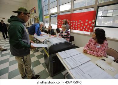 VENTURA COUNTY, CA - JUNE 7, 2016 -- Hispanic male turns in ballot at Ventura Polling Station for California primary Ventura County, California.