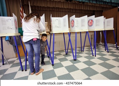 VENTURA COUNTY, CA - JUNE 7, 2016 -- Boy looks under voting booth at Ventura Polling Station for California primary Ventura County, California.