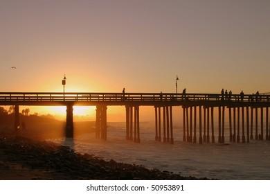 The Ventura pier at sunrise at the beach.