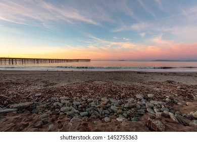 Ventura Pier at sunrise with pebbles in the foreground
