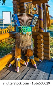 "Venue of the international festival ""Play, accordion"", Zavolokinskaya village, Novy Sharap Village, Ordynsky district, Novosibirsk region, Russia-October 13, 2019: Accordion on chicken legs"