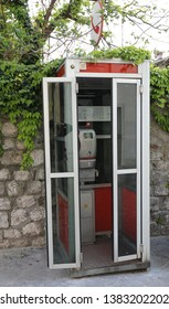 Venzone, UD, Italy - April 22, 2019: old Italian phone booth with coin-operated telephone set