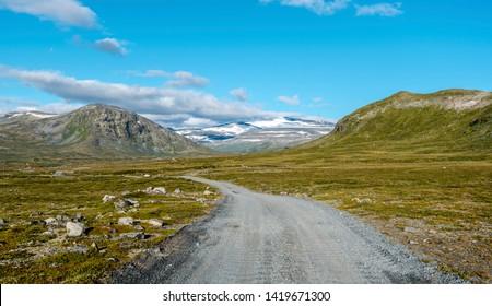 Veodalsvegen ground road in the direction of Jotunheimen mountain area, Glittertind mountain is visible in center. Oppland, Norway.