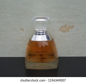 Vera Wang, fragrance for ladies, big perfume bottle in front of the satin wallcovering Elysee Kassel, Germany, September 15, 2018: Vera Wang is an American fashion designer of Chinese descent.