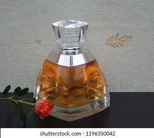 Vera Wang, fragrance for ladies, big perfume bottle in front of the satin wallcovering Elysee decorated with a rose Kassel, Germany, September 15, 2018: Vera Wang is an American fashion designer