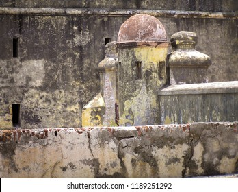 Veracruz, Mexico - April 25, 2015: A detail in the architecture with a yellow watch tower and red dome in San Juan de Ulúa prison-museum.
