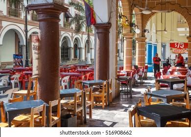 VERACRUZ / MEXICO - JAUNARY 2014: Street restauraunts are waiting for customers in the historic centre, Veracruz, Mexico