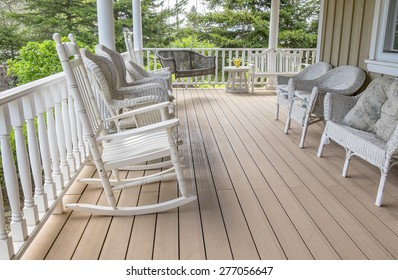 Veranda Filled With White Wicker Chairs, With a Rocking Chair in the Foreground