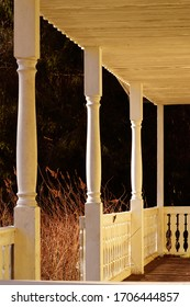 Veranda on pillars. This stylish, vintage veranda, lit by sunlight, creates a cozy look.