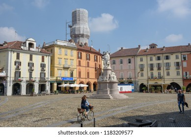 Vercelli, Italy - 8 September 2018: people walking on central Cavour square at Vercelli on Italy