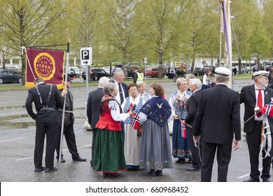 VERDAL, NORWAY - MAY 17, 2017: National day in Norway. Norwegians at traditional celebration and parade  on may 17, 2017 in Verdal. People on parde before school in Verdal.