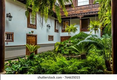 A verdant courtyard off Saint Agustin street in San Christobal de La Laguna, Tenerife on a sunny day