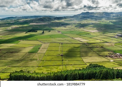 Verdant landscape in caldera of old volcano with pastures and views of the Atlantic Ocean in Serra do Cume, Terceira - Azores PORTUGAL