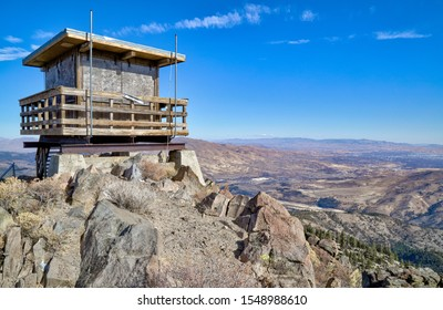 Verdi Peak, California, United States - October 31st, 2019: An abandoned fire lookout sits atop Verdi Peak in the eastern Sierra mountains overlooking the Reno-Sparks Nevada metro area.