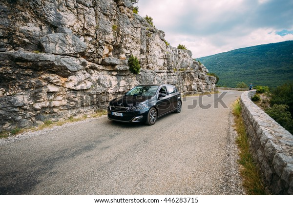 Verdon, France - June 29, 2015: Black colour Peugeot 308 5-door car on background of French mountain nature landscape. The Peugeot 308 is a small family car produced by French car manufacturer Peugeot