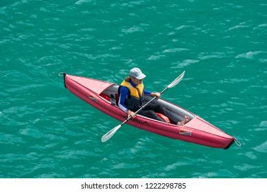 Verdon Gorge canyon, France - April 15, 2017: Man kayaking in Verdon Gorge canyon.
