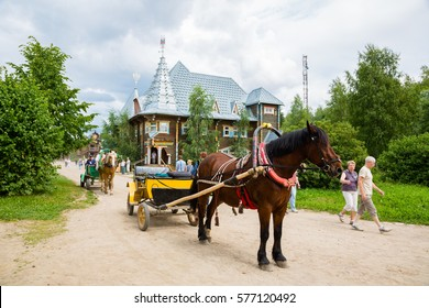 VERHNIE MANDROGI, RUSSIA - CIRCA JUNE, 2016: Old-fashioned carriage in the russian tourist center Verhnie Mandrogi. Center serves tourists and cruise the passenger ships by the river Svir.