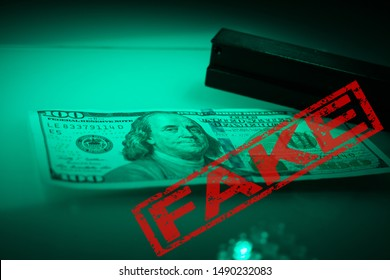 Verifying the authenticity of the hundred dollar bill. US banknotes, Benjamin Franklin's portrait. Equipment for in-depth inspection of money. Fake money. Detection of the counterfeit US Money concept