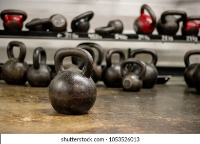 verious pictures of kettle ball on a rack but not in order