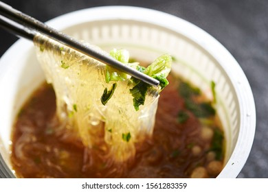 Vermicelli noodle with soup, eating with chopsticks