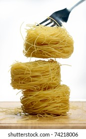 Vermicelli pasta nests on white background