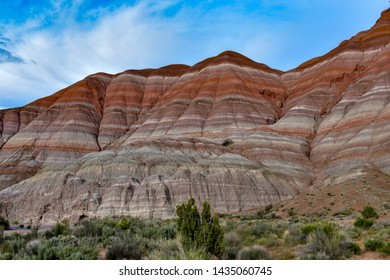 Vermilion Cliffs in the Grand Staircase Escalante National Monument on the Arizona and Utah border. The cliffs have layers of rocks with different colors.
