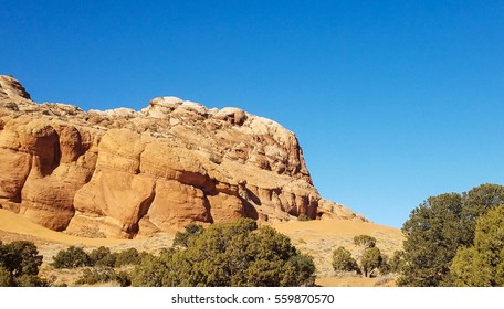 vermilion cliffs red rocks blue sky white clouds