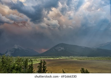 Vermilion lakes in Banff with Smoky dramatic clouds from the Wildfires overhead
