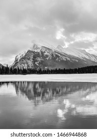 Vermilion Lakes during Winter in the Canadian Rockies of Banff National Park showing Mt Rundle and its reflections.