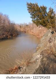 Vermilion River flows high through Kickapoo State Park in Illinois