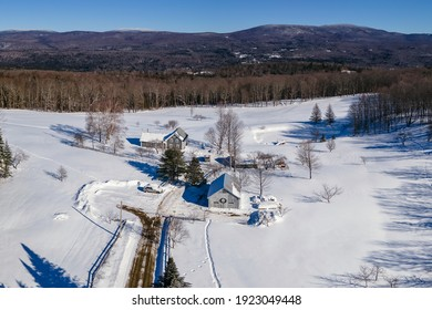 Vermont Homestead During Winter With Blue Skies
