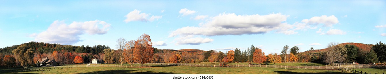 Vermont peaceful panoramic view of fall foliage farm with cows and horse on background