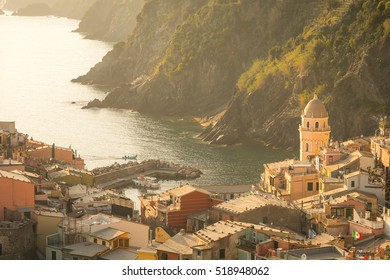 Vernazza, Cinque Terre, Liguria Aerial view of village, famous world heritage Italian site. Church,Fishing harbor with boats, deep blue sea,colorful houses,dramatic coastal scenery at Sunset in Summer